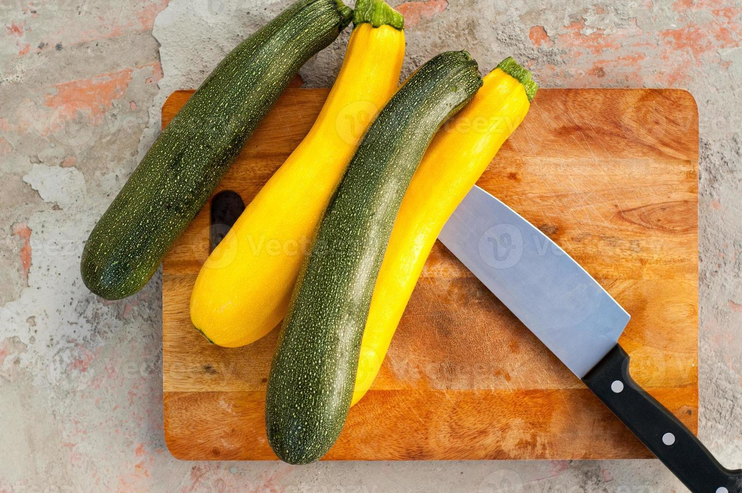 Sliced zucchini on wooden cutting board photo