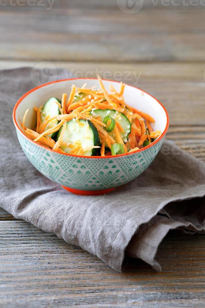 Fresh salad with cucumber and carrot photo