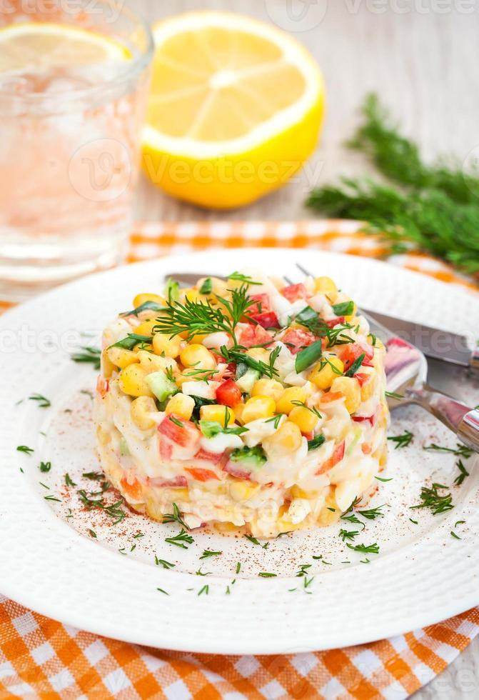 Fresh vegetable and crab salad with mayonnaise photo