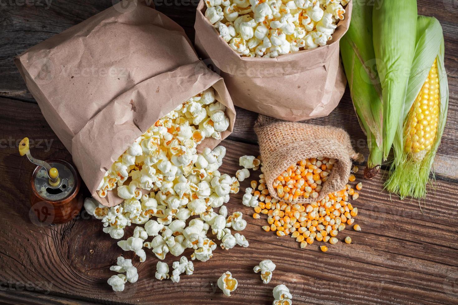 Corn and popcorn in rustic version photo