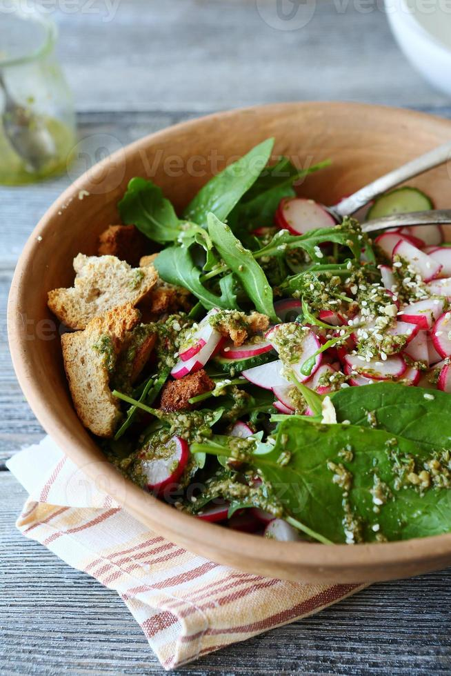 salad with fresh greens and vegetables photo