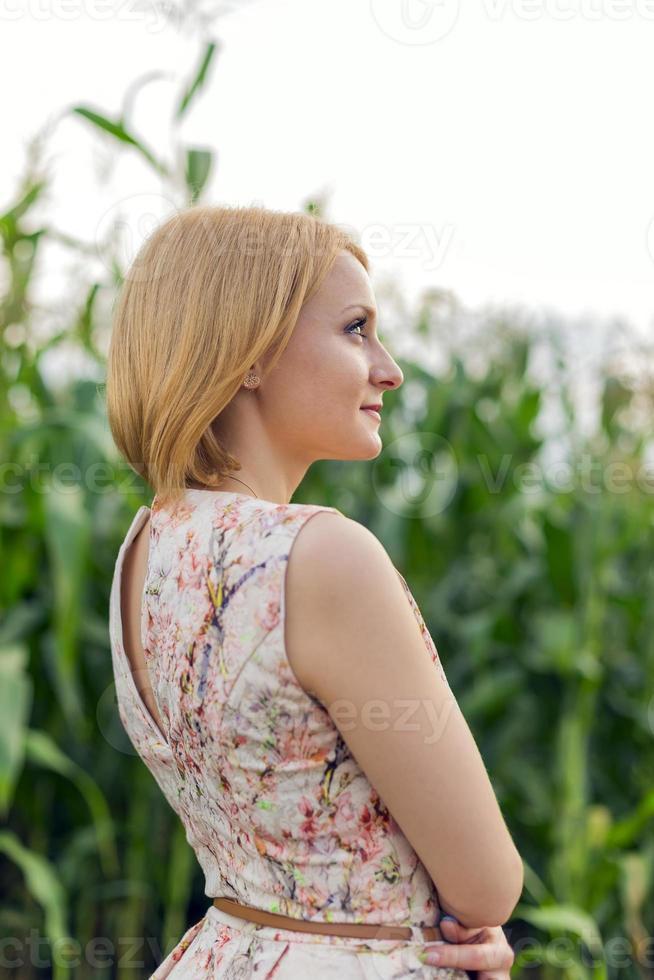 Girl at corn photo