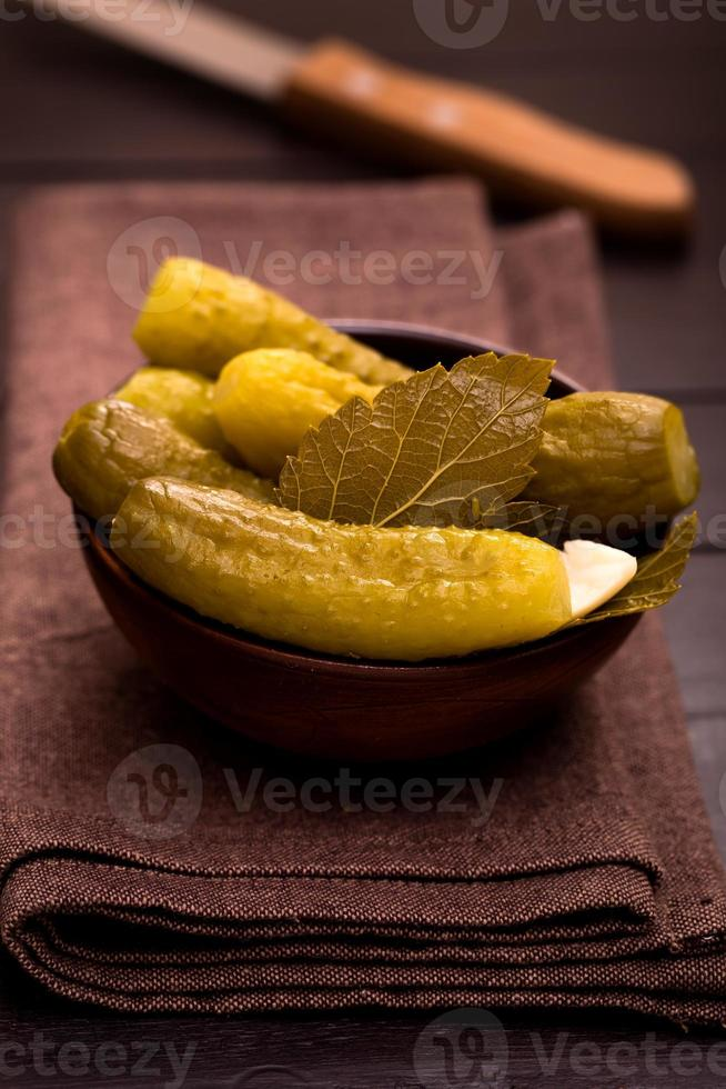 Bowl of pickled cucumbers photo