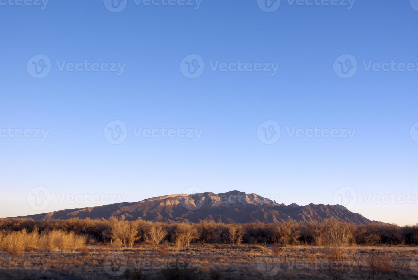 Sandia Mountains with clear sky at sunset photo