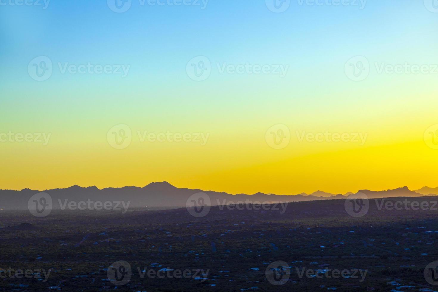 golden sunset in Tuscon, Arizona with mountain range photo