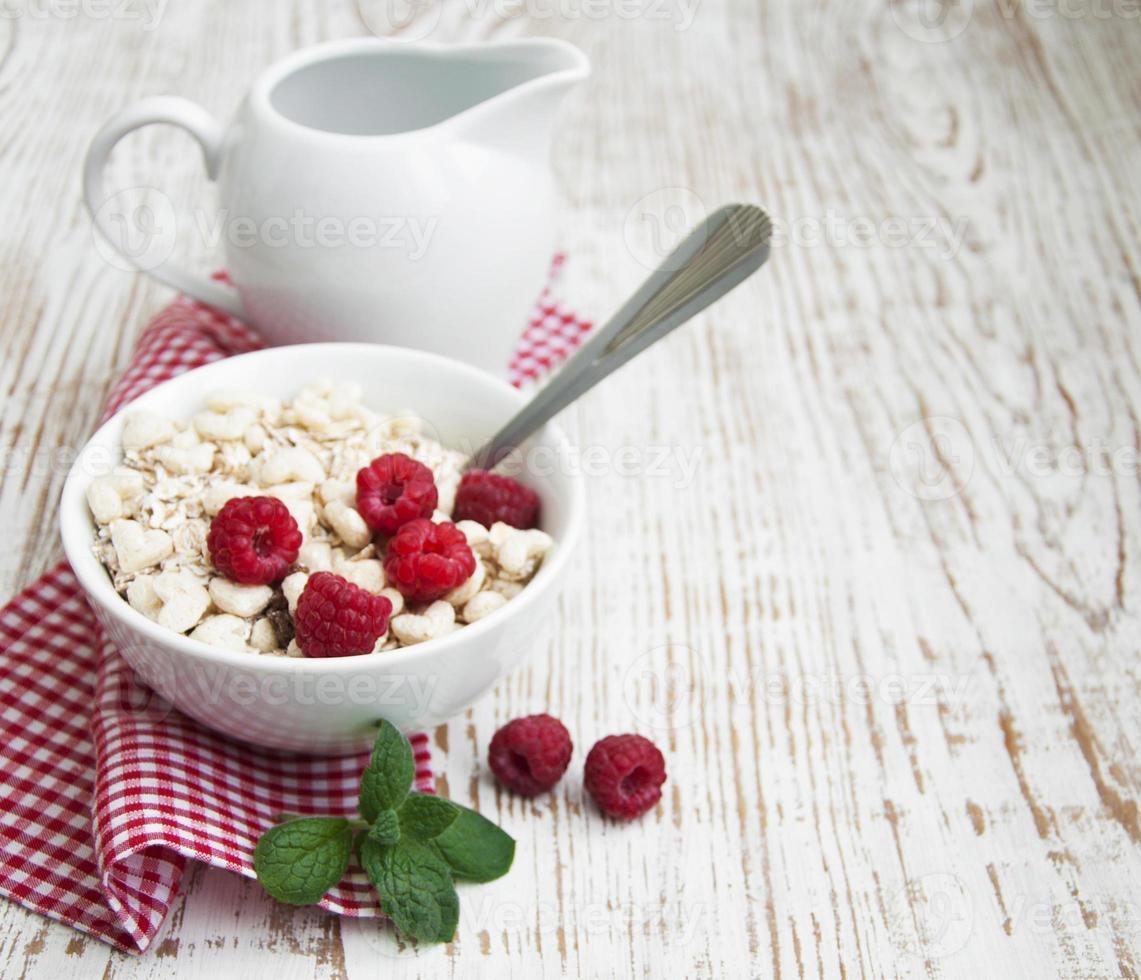 grain muesli with raspberries photo