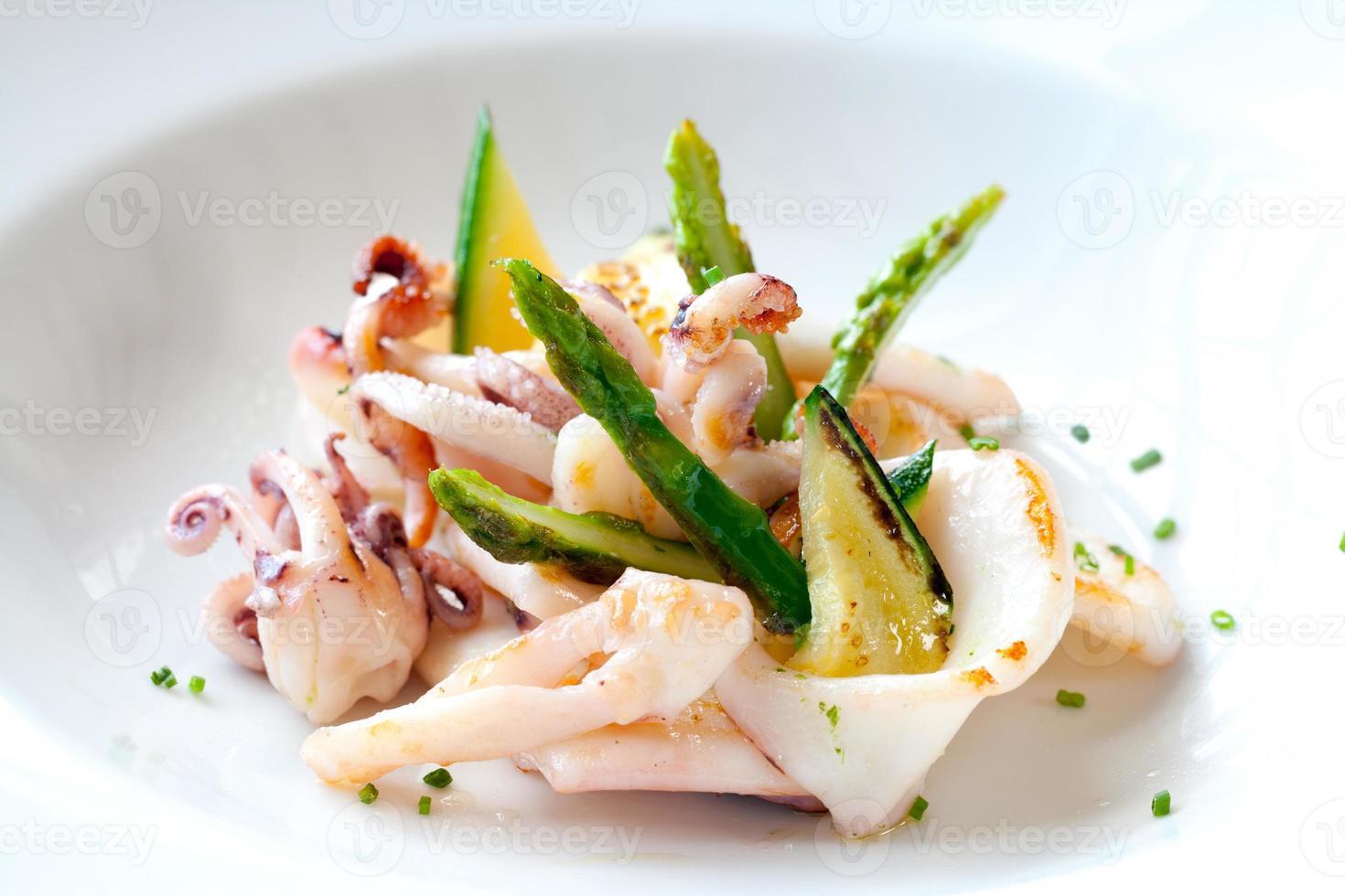 Grilled calamari with green asparagus. photo