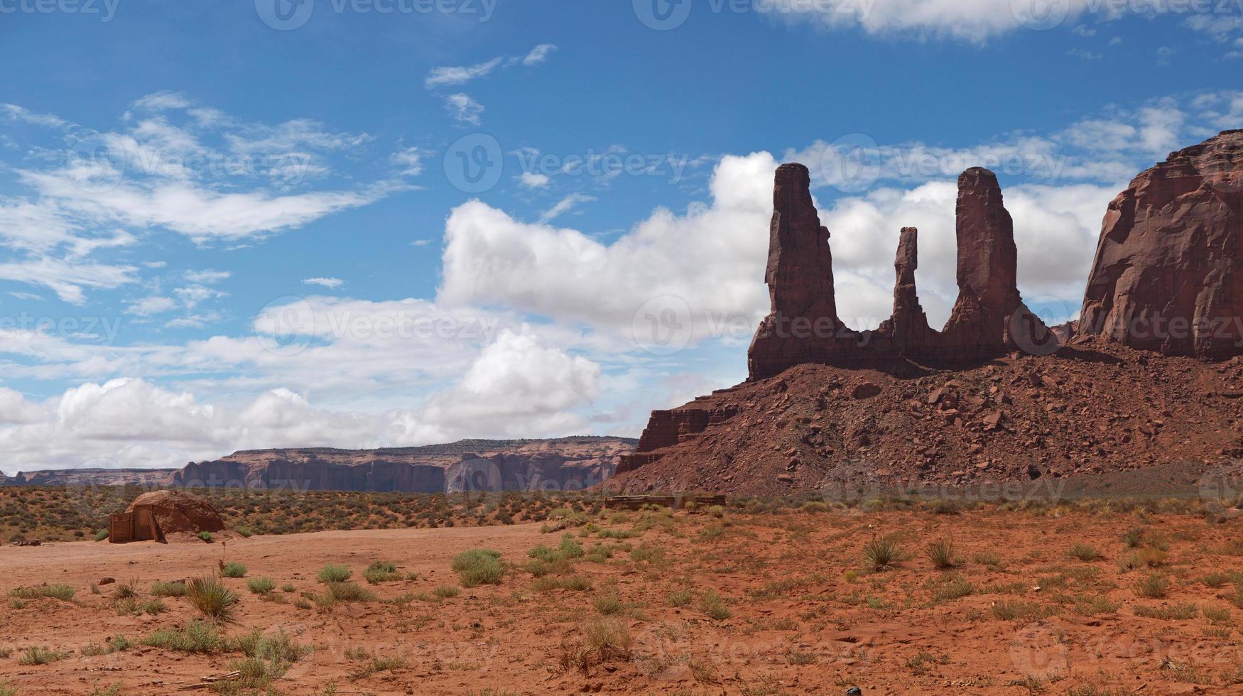Three Sisters and Navajo Hogan photo