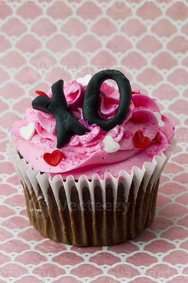strawberry cupcake with heart shape and alphab photo