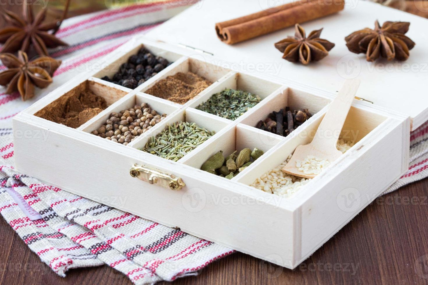 Assortment collection of spices and herb in wooden box, food photo