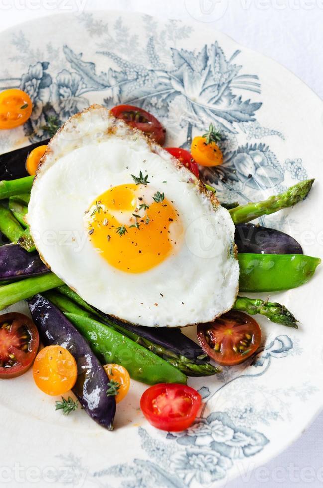 Egg on fresh healthy vegetables light meal option photo