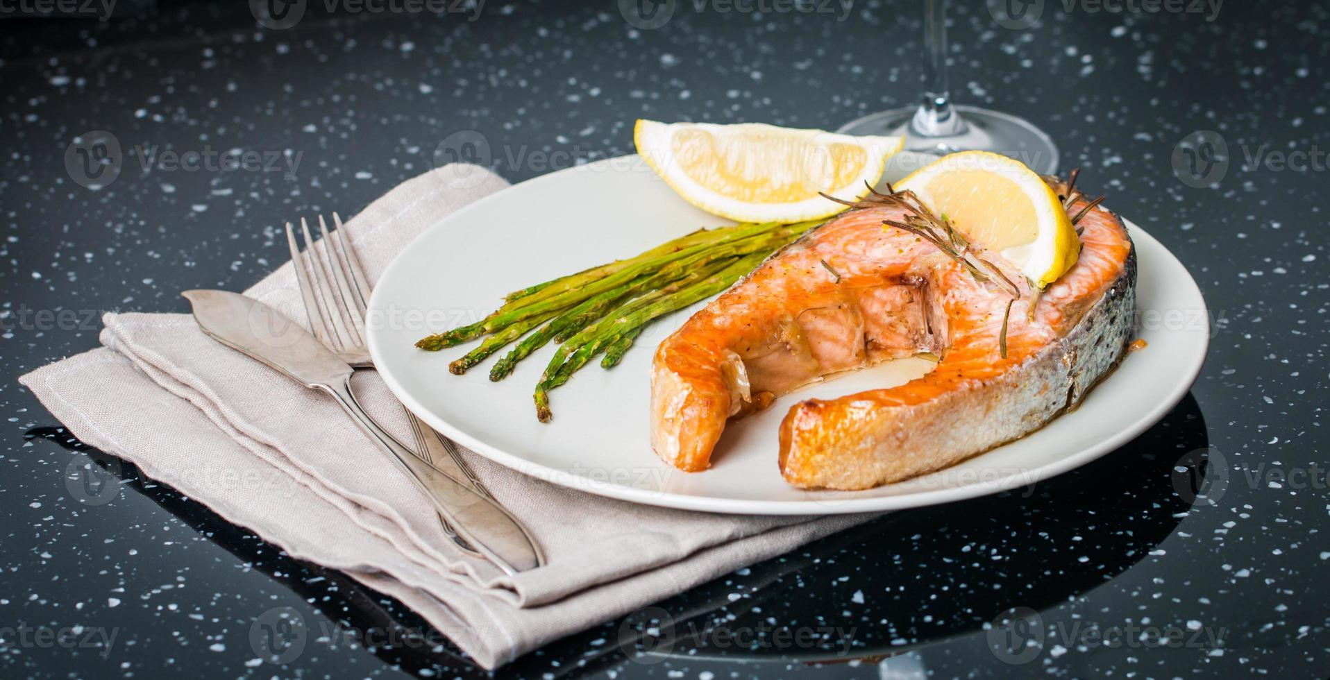 Grilled steak of salmon with vegetables and wine photo