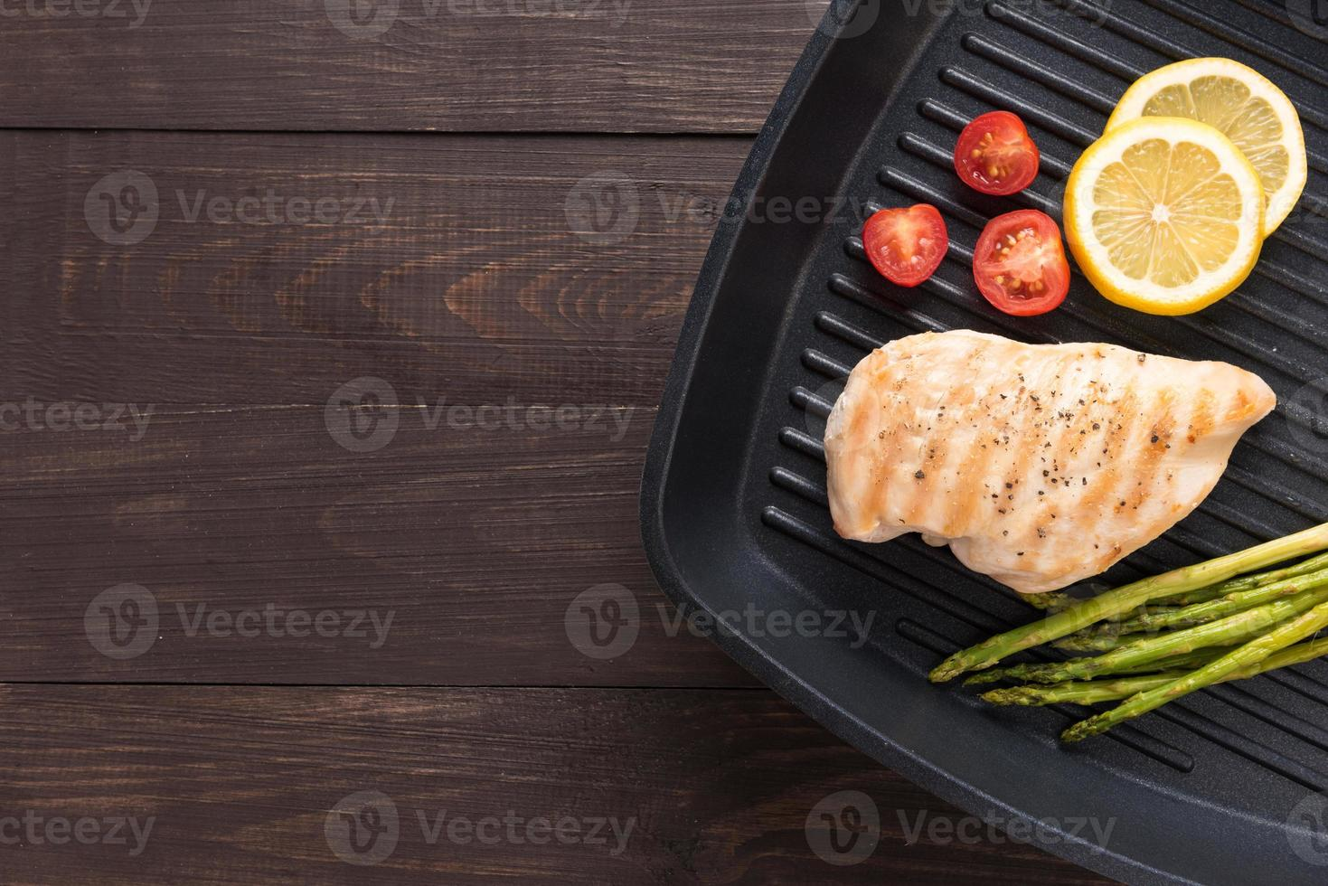 Marinated grilled chicken breasts cooked BBQ on a pan photo