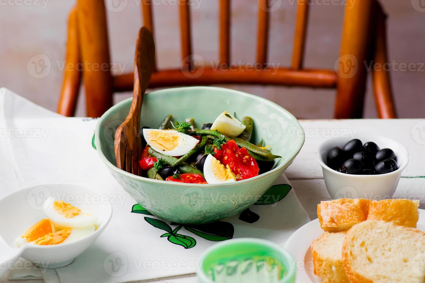 Salad from green beans with olives and egg photo