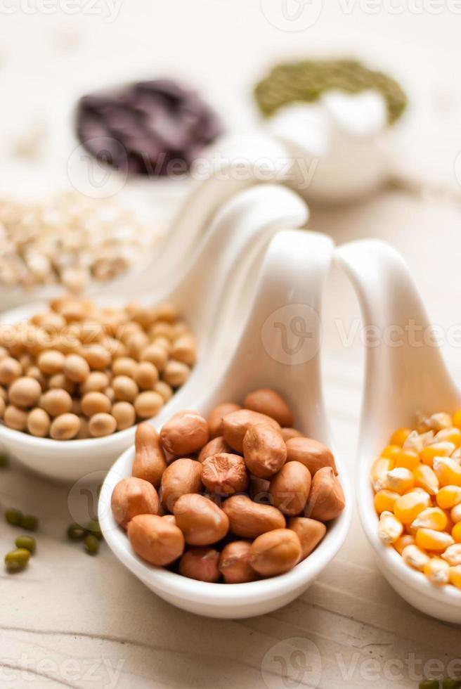 Different kinds of bean seeds, lentil, peas photo