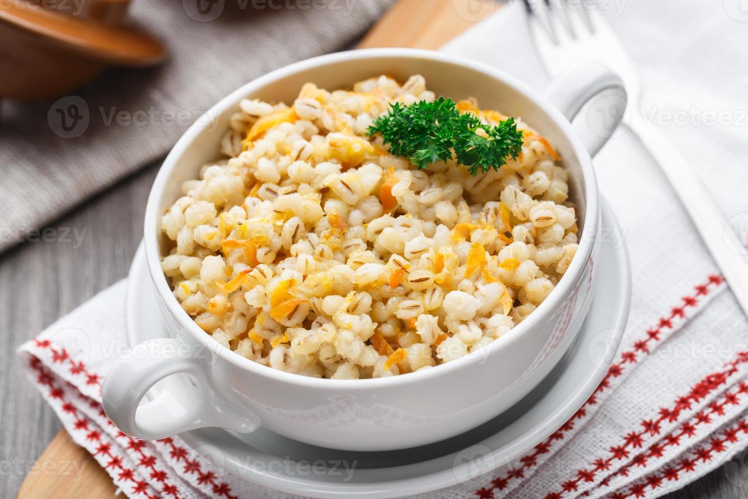 Barley porridge with carrot and onion photo