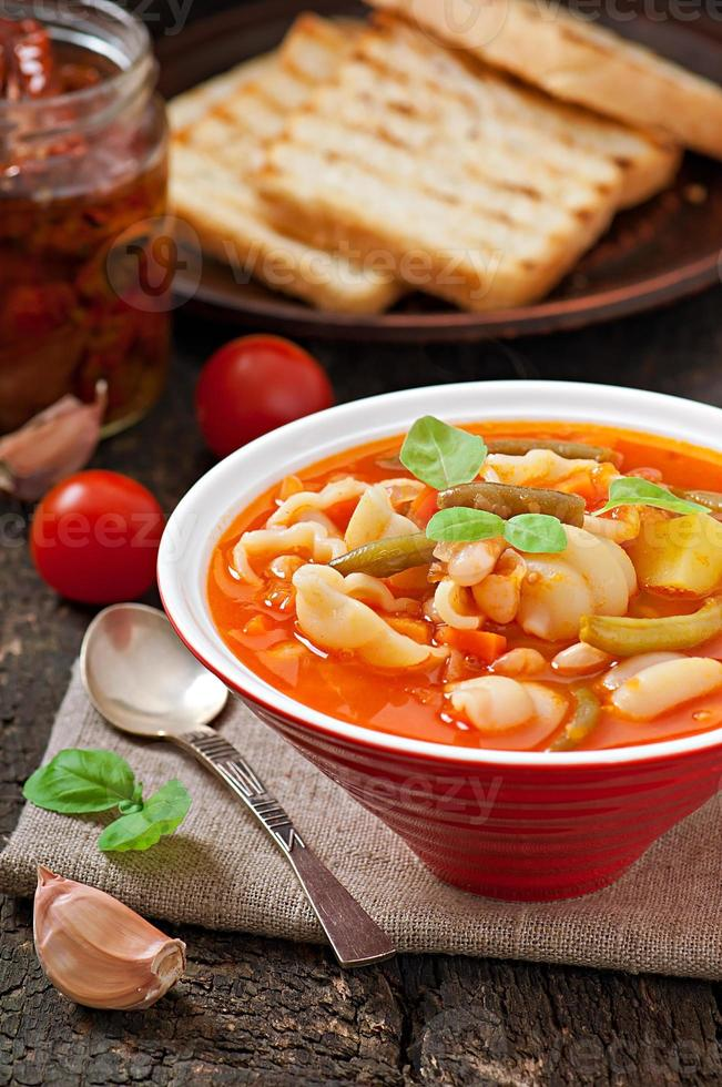 Minestrone, italian vegetable soup with pasta photo