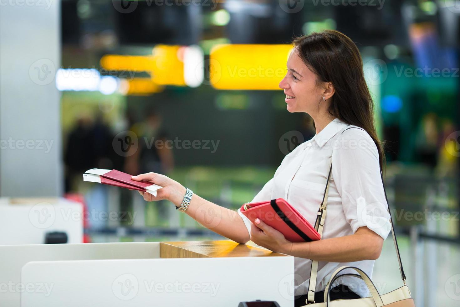Women holding passports and boarding pass at airport photo
