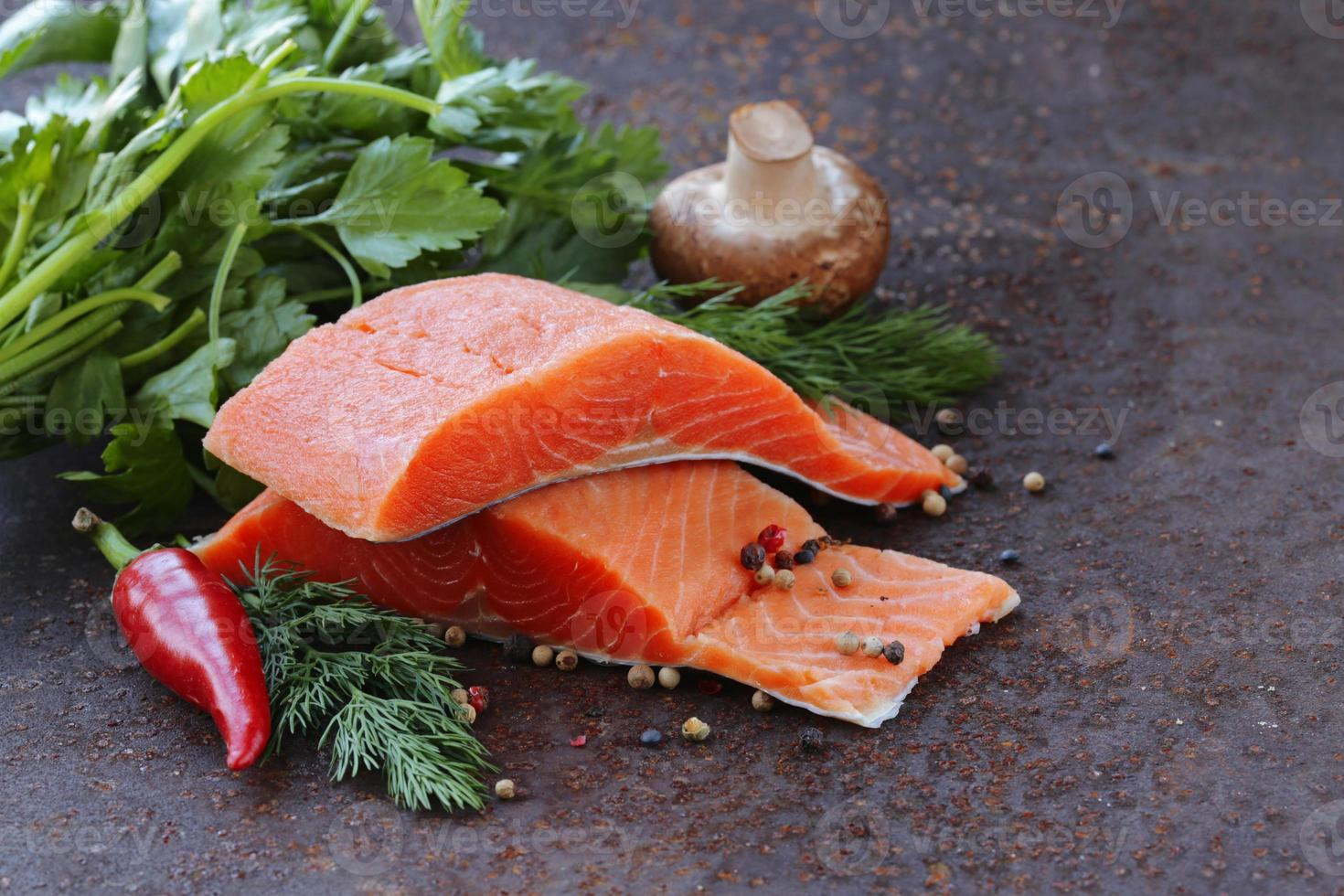 fresh salmon (red fish) fillet with herbs, spices and vegetables photo
