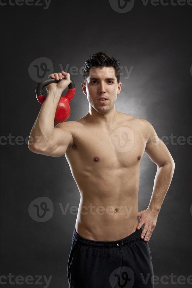 man training with kettlebell photo