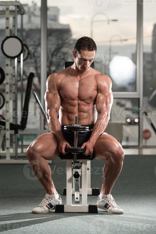 Young Man Exercise With Dumbbells photo