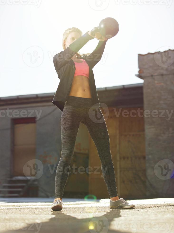 Swinging the Kettle bell Outdoors photo