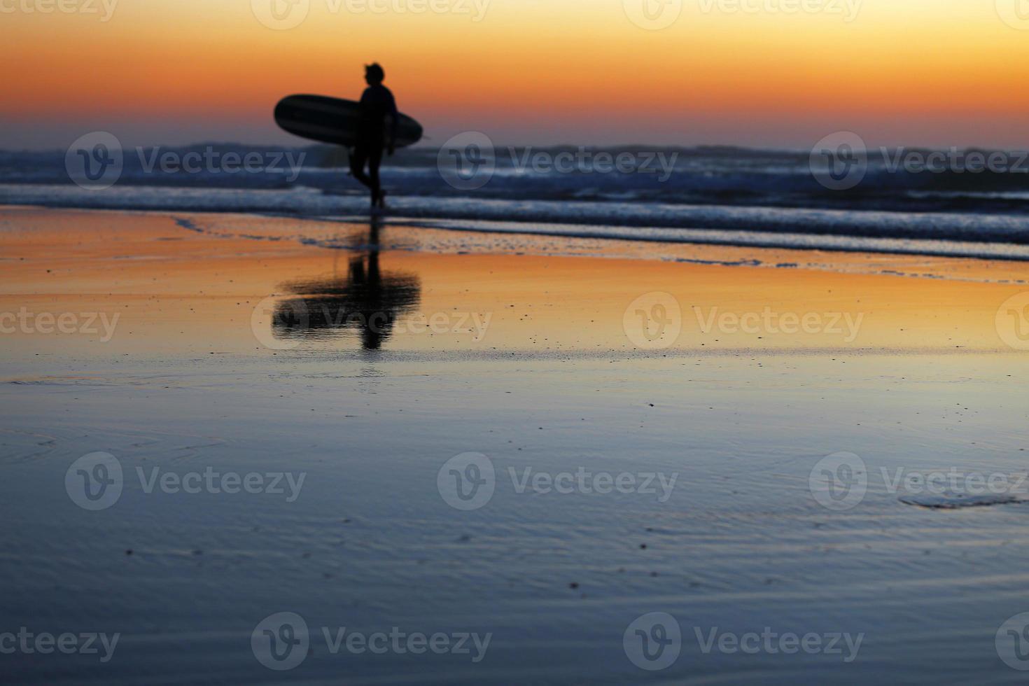 sunset surfer photo
