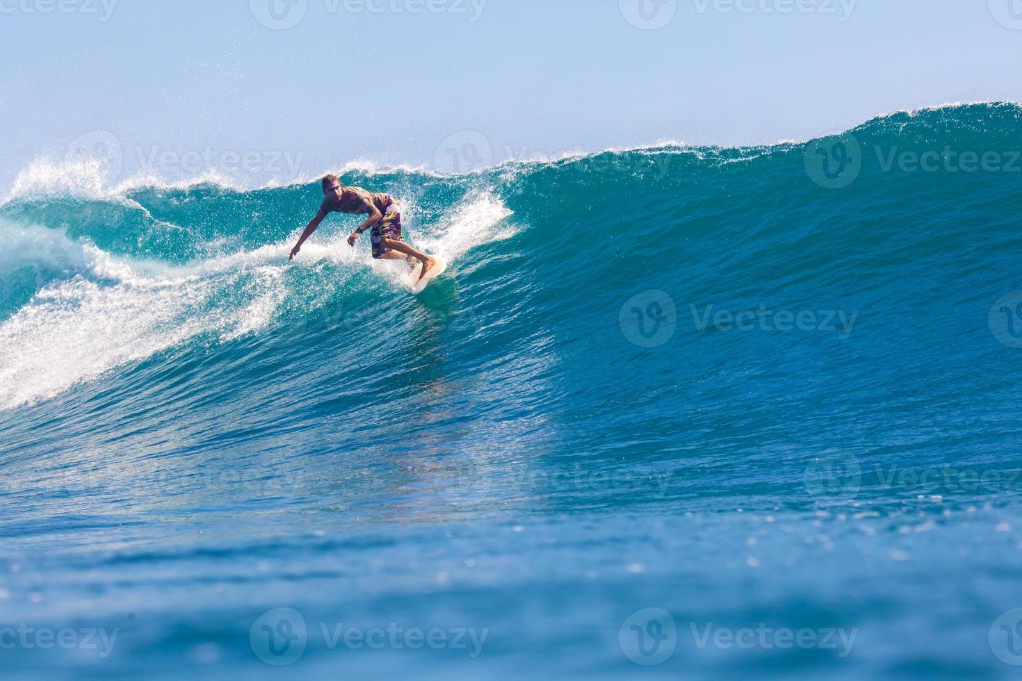 Surfing a Wave. Bali Island. Indonesia. photo
