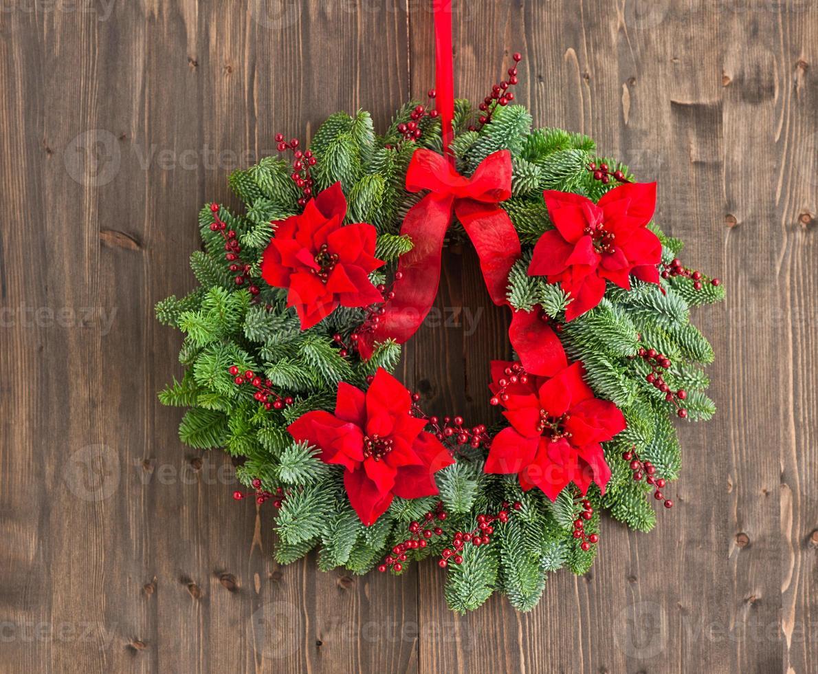 coroa do advento com rosa de inverno foto
