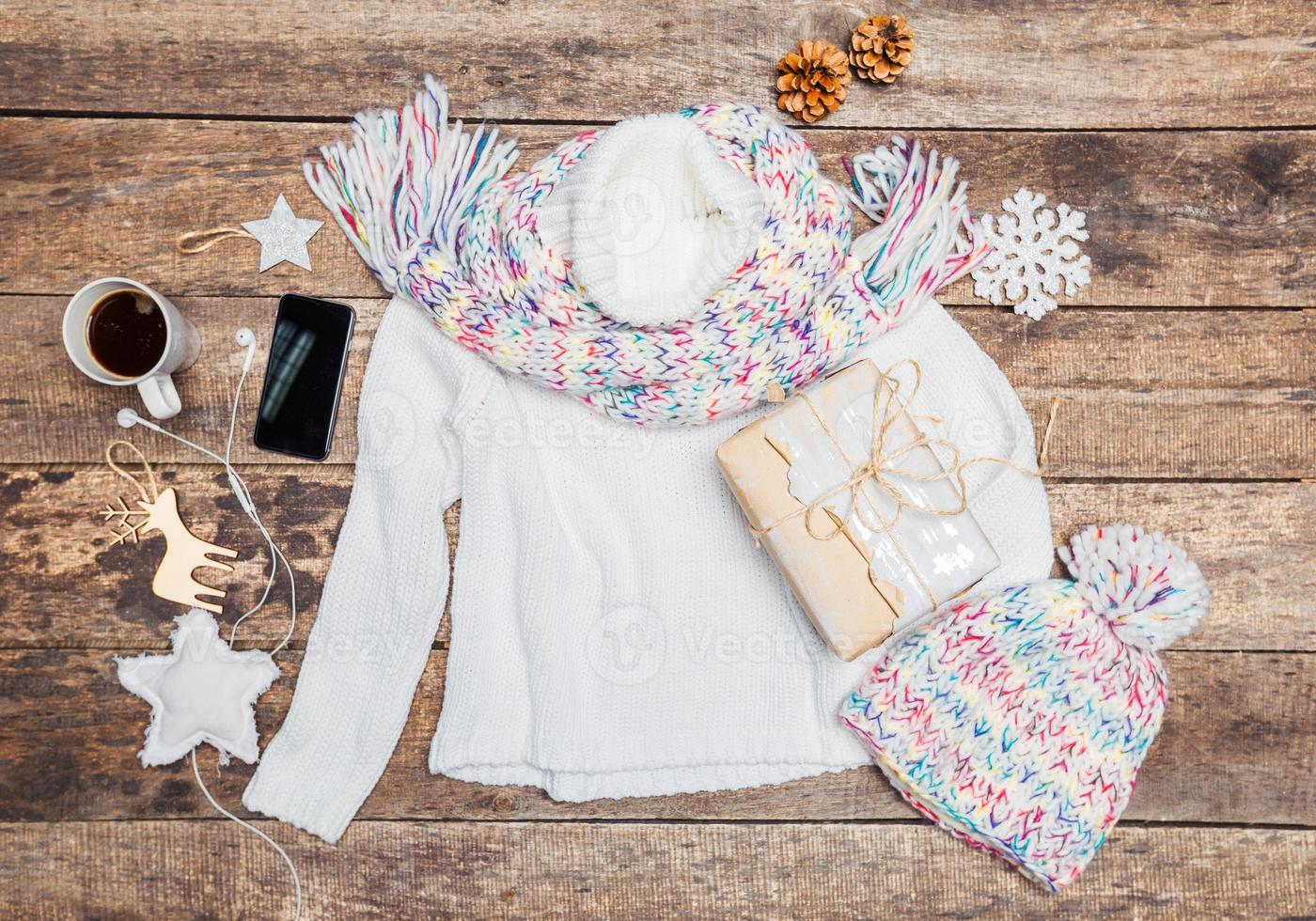 Winter clothes on wooden background. photo