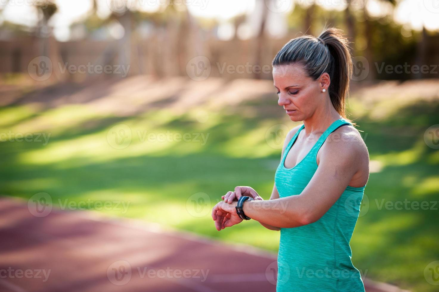 image of a female athlete adjusting her heart rate monitor photo