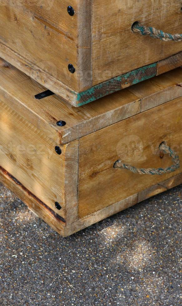 Old wooden boxes with rope handles on street photo