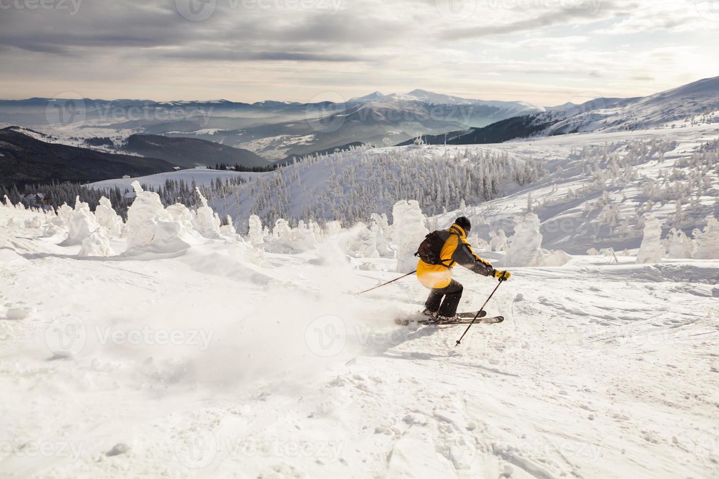 Man Snow Skiing Against Blue Sky photo