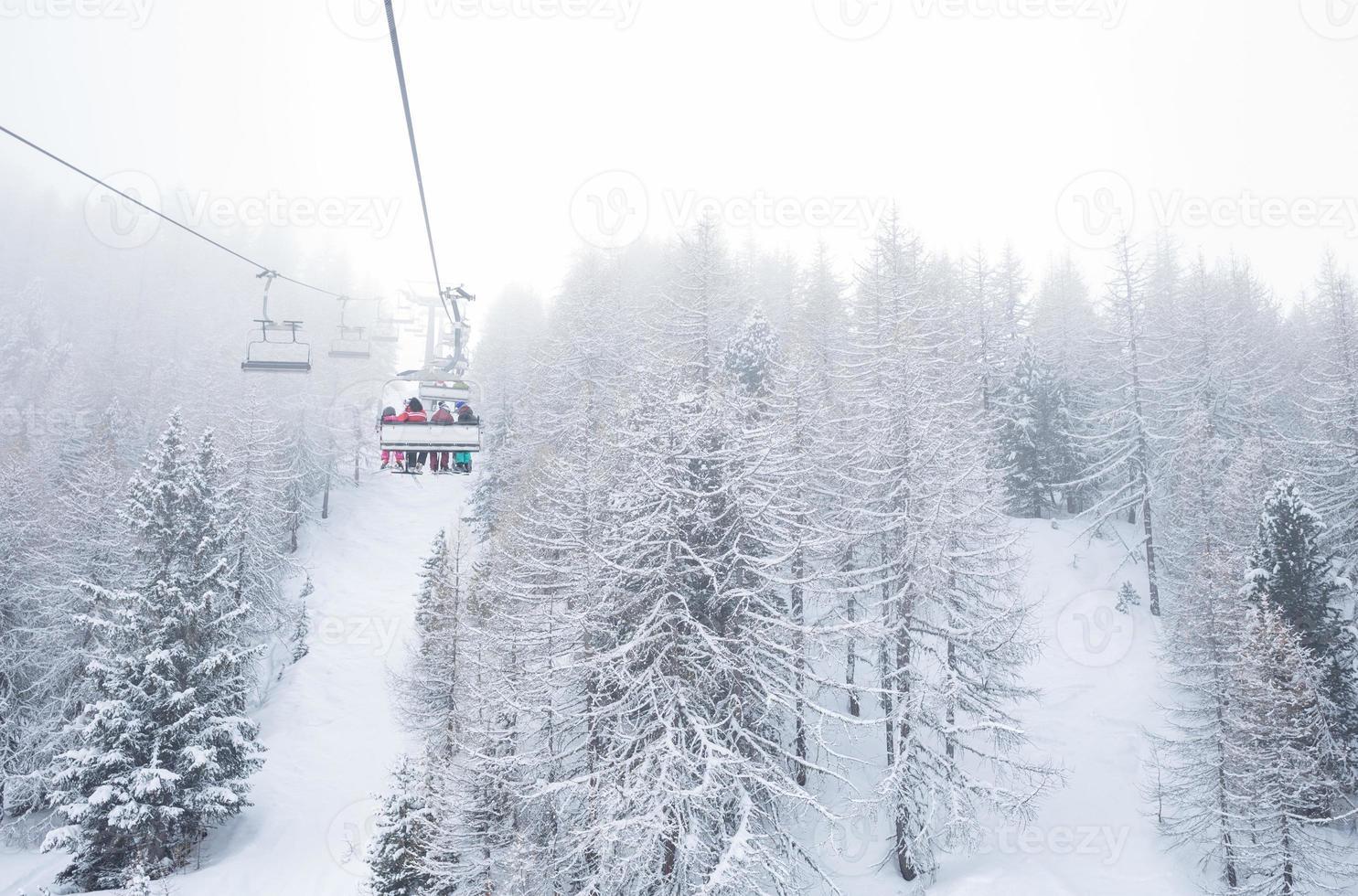 Ski lift with passengers in the gondola photo