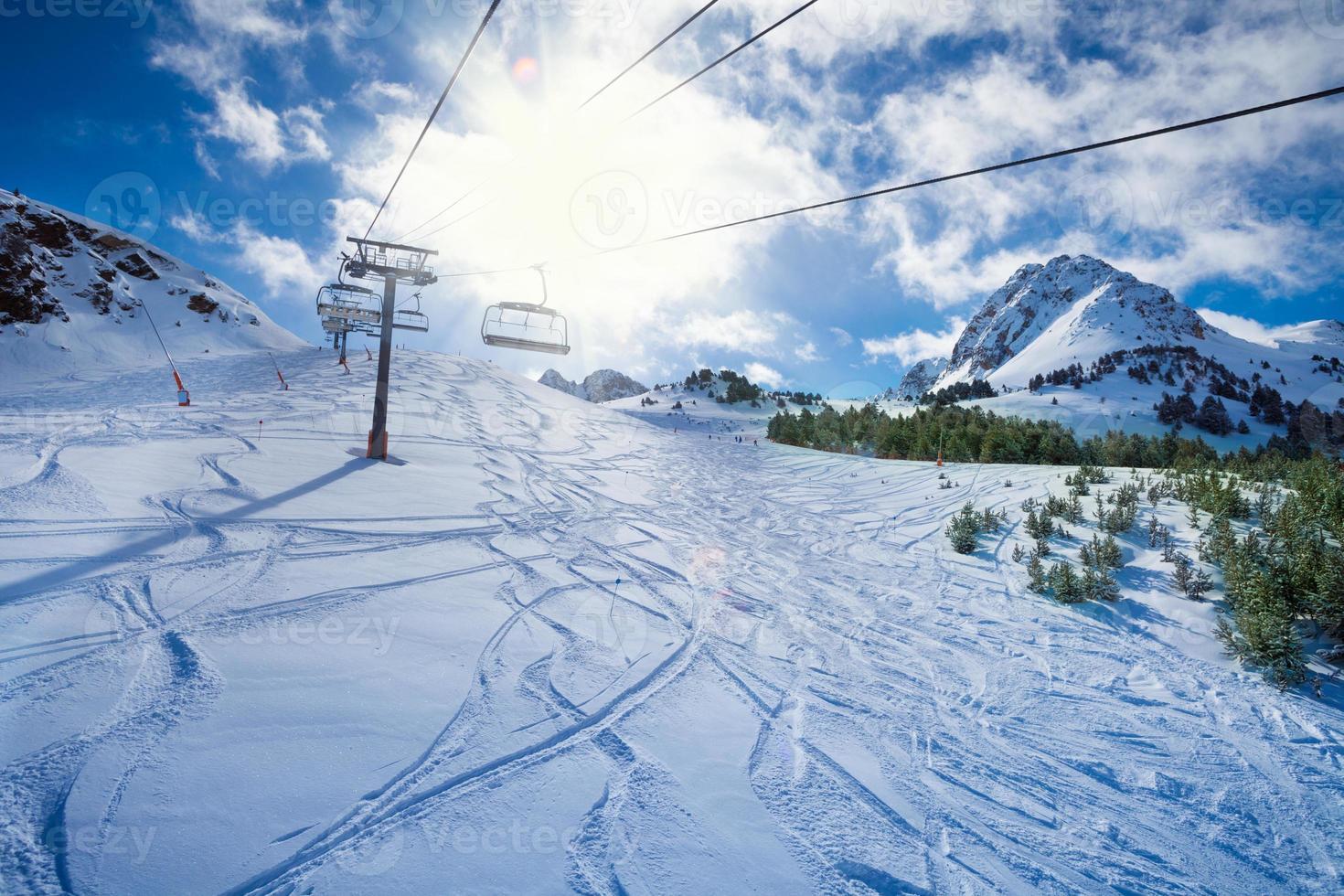 Ski lift on a snow covered mountain photo