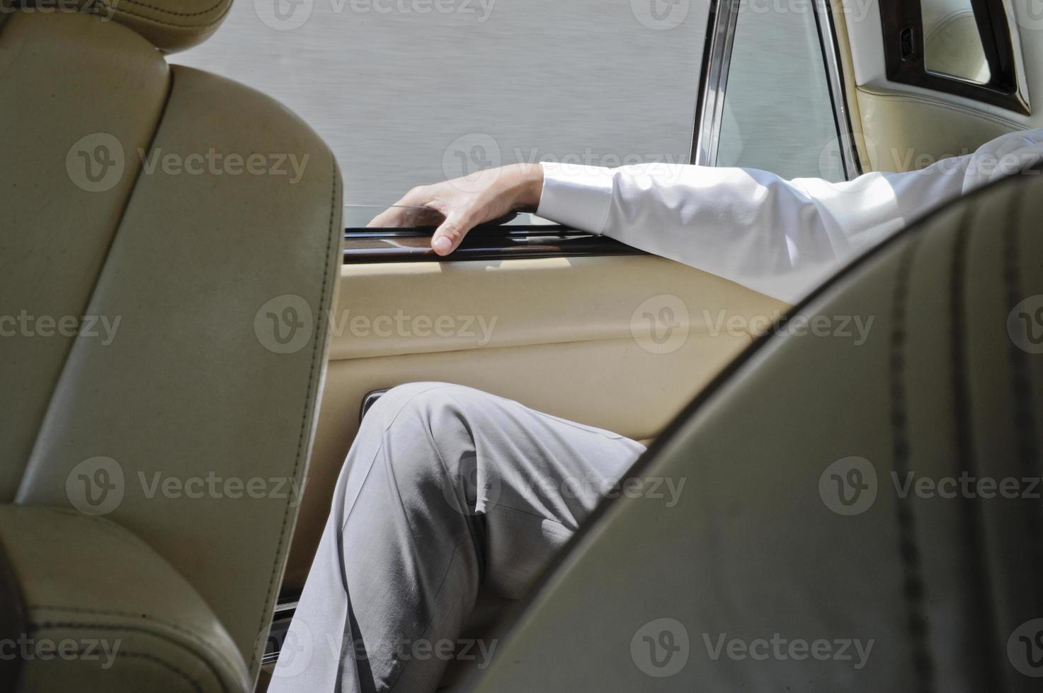 man behind a car photo