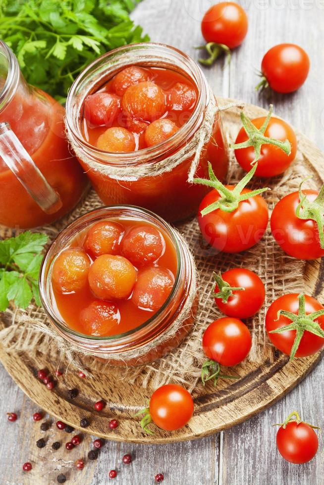 Canned tomatoes in tomato juice photo