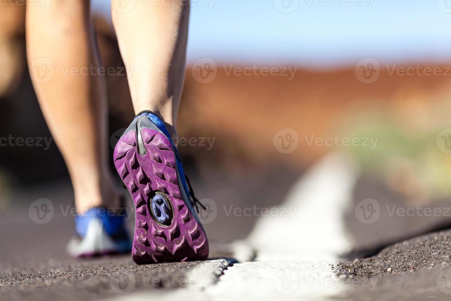 Walking or running legs in mountains, adventure and exercising photo