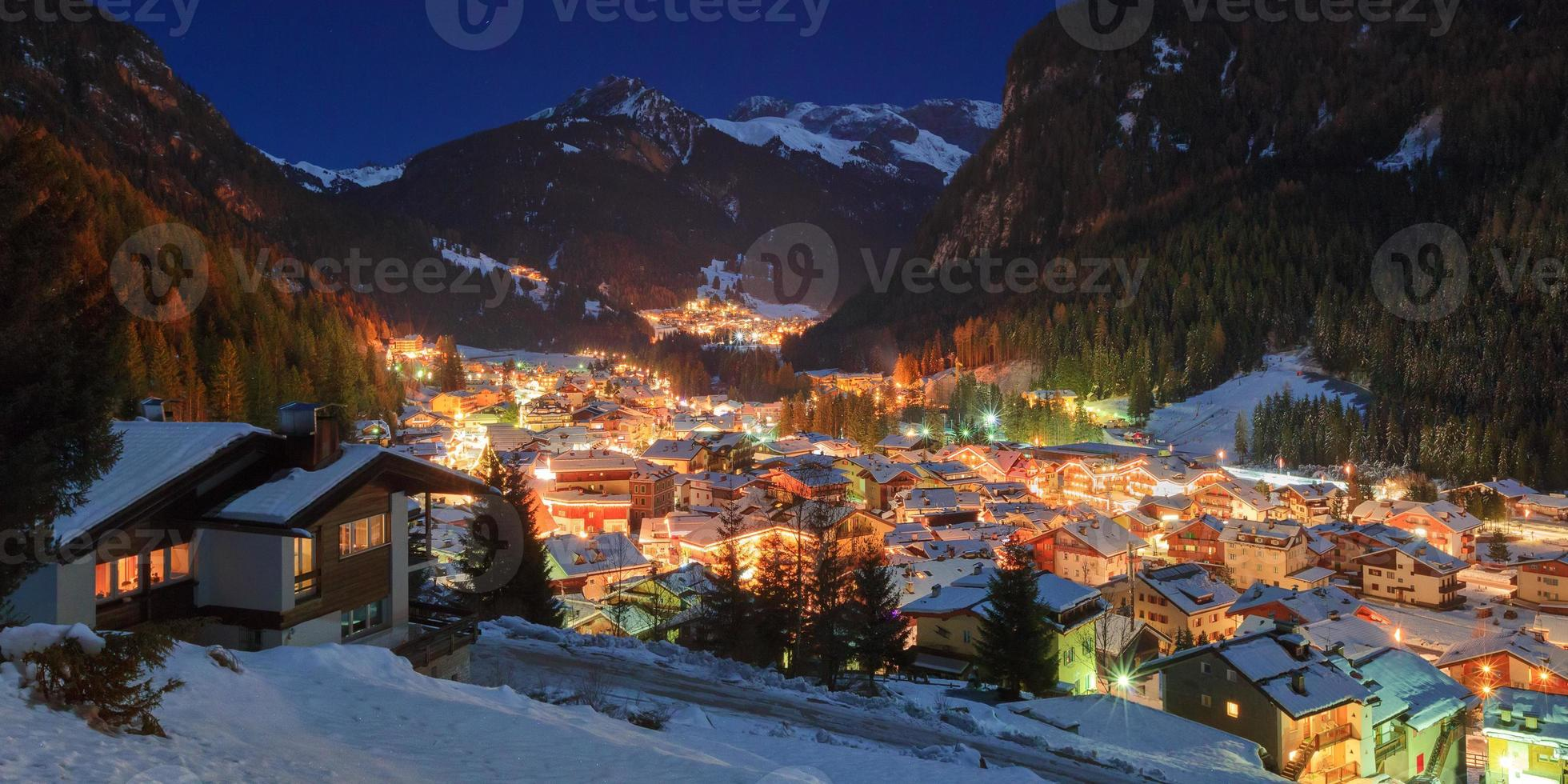 Winter landscape of village in the mountains photo