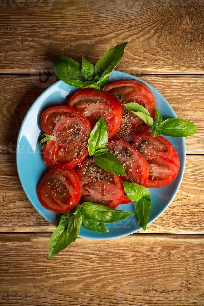 Tomatoes with basil photo
