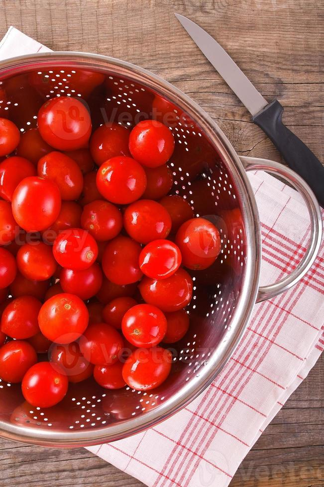 Tomatoes in colander. photo