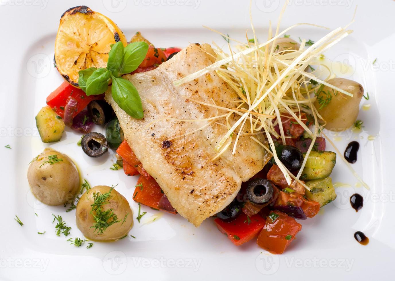 Fish with grilled vegetables photo