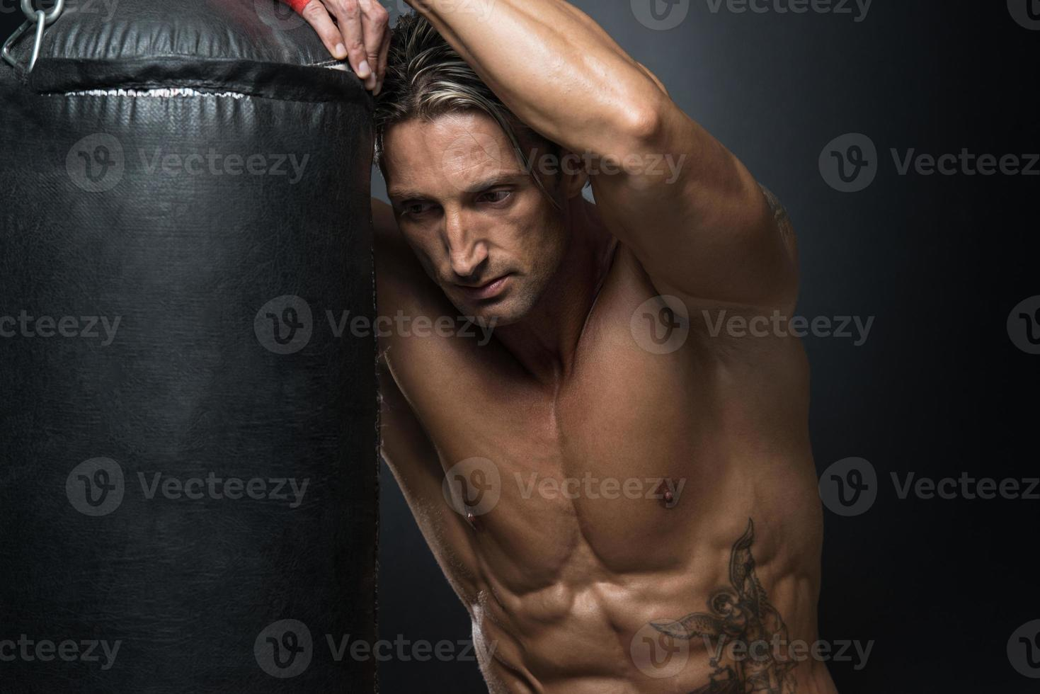 MMA Fighter Practicing With Boxing Bag photo
