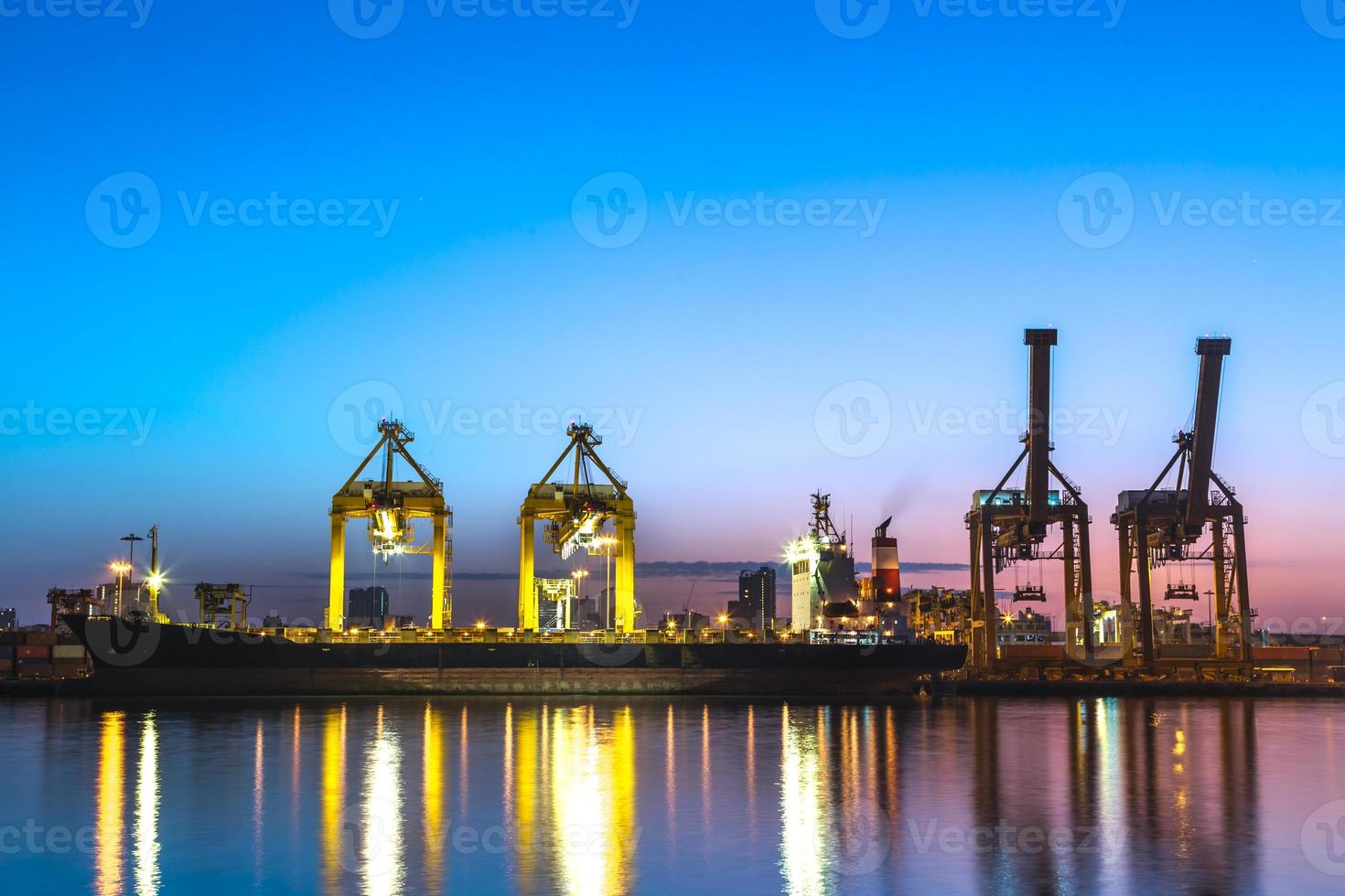 Container Cargo freight ship working crane bridge in shipyard photo