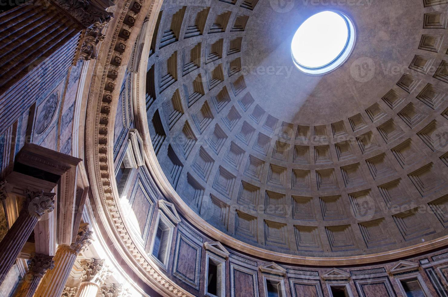 Interior of Rome Pantheon with the famous ray of light photo