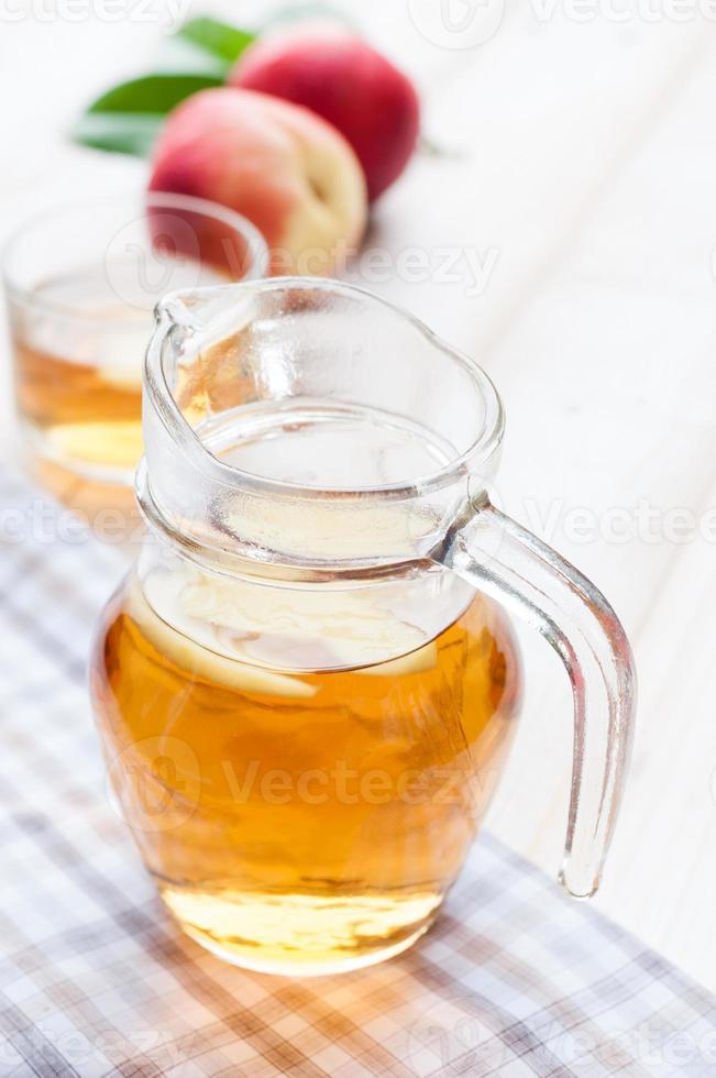 tarro de té de durazno foto