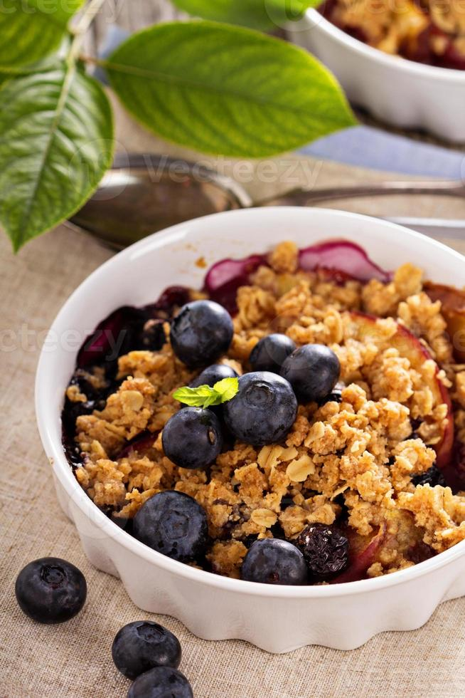 Peach and blueberry summer crumble photo