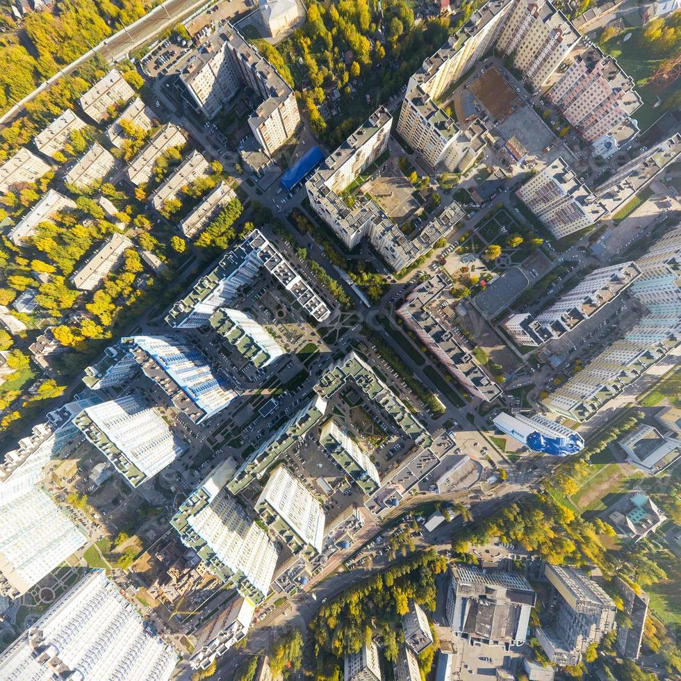 Aerial city view with crossroads, roads, houses, buildings and parks photo