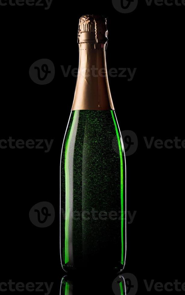 Green bottle of champagne photo