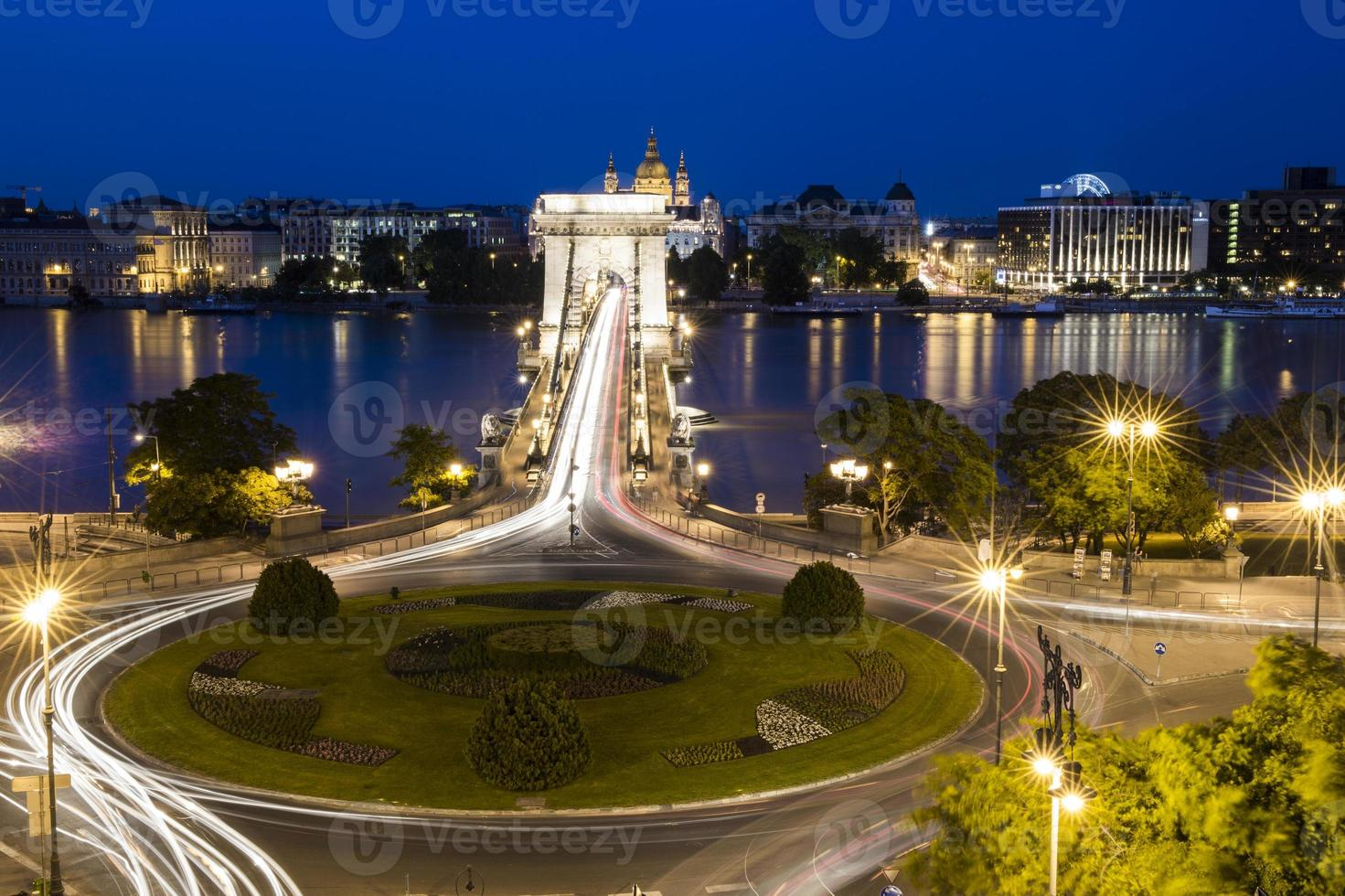 roundabout with light streaks, bridge and tiber photo